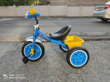 Детский трехколесный велосипед с музыкой