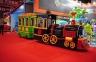 Аттракцион для детских развлекательных игровых центров 24-х местный паровоз на колесах.